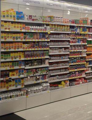 Pharmacy store shelving - vitamins supplements rack
